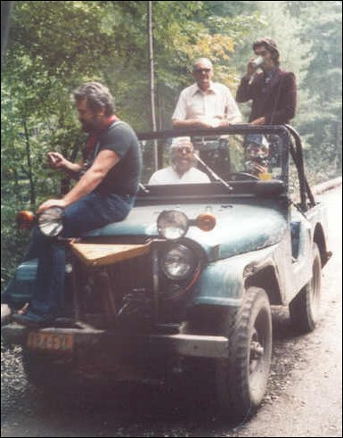 Ronnie Hawkins on hood, Levon Helm driving, Albert Grossman, back left, Diamond Helm and Robbie Robertson and RCO Album release party Woodstock NY 1977