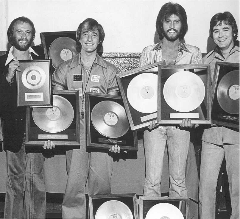Paul presents Bee Gee's with Gold Records at the O'Keefe